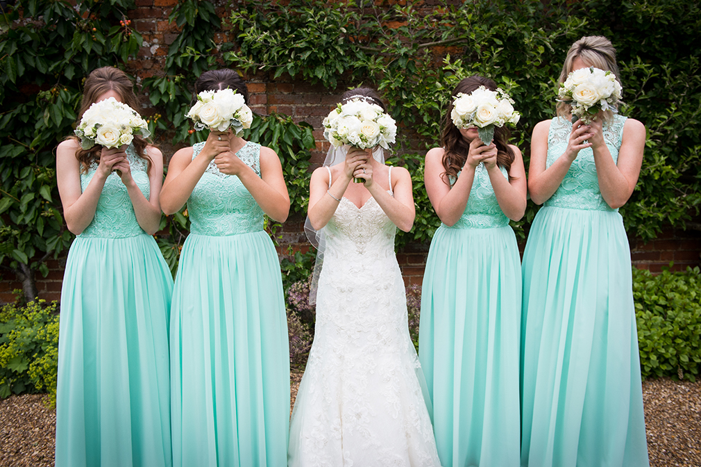 Madeline's bridesmaids wore mint green bridesmaid dresses to go with their wedding colour scheme