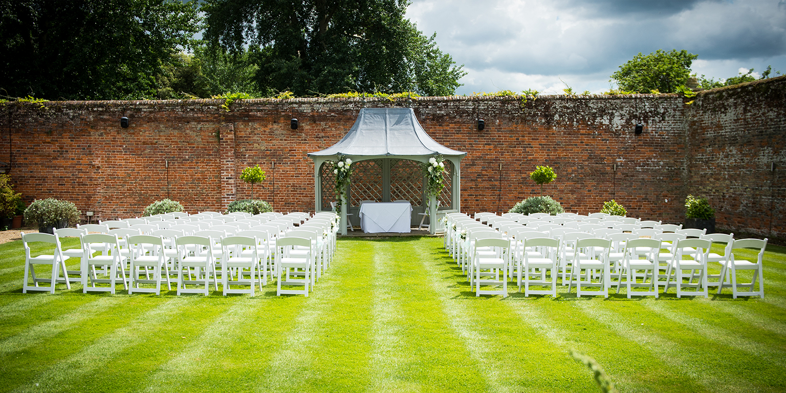 Hold your outdoor wedding in a memorable setting like the beautiful walled garden at Braxted Park