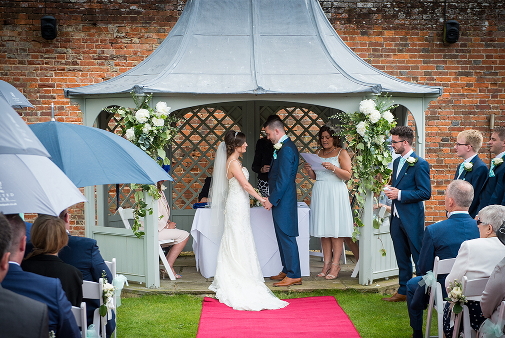 Madeline and Martyn say their marriage vows in an outdoor wedding ceremony