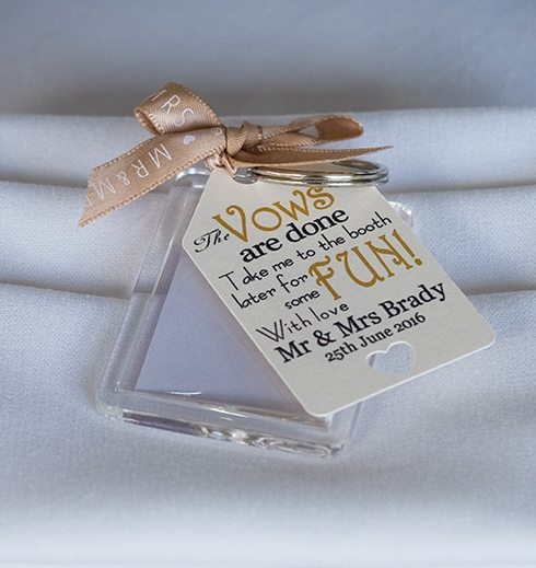 A wedding photobooth token keyring is a fantastic wedding favour for your guests