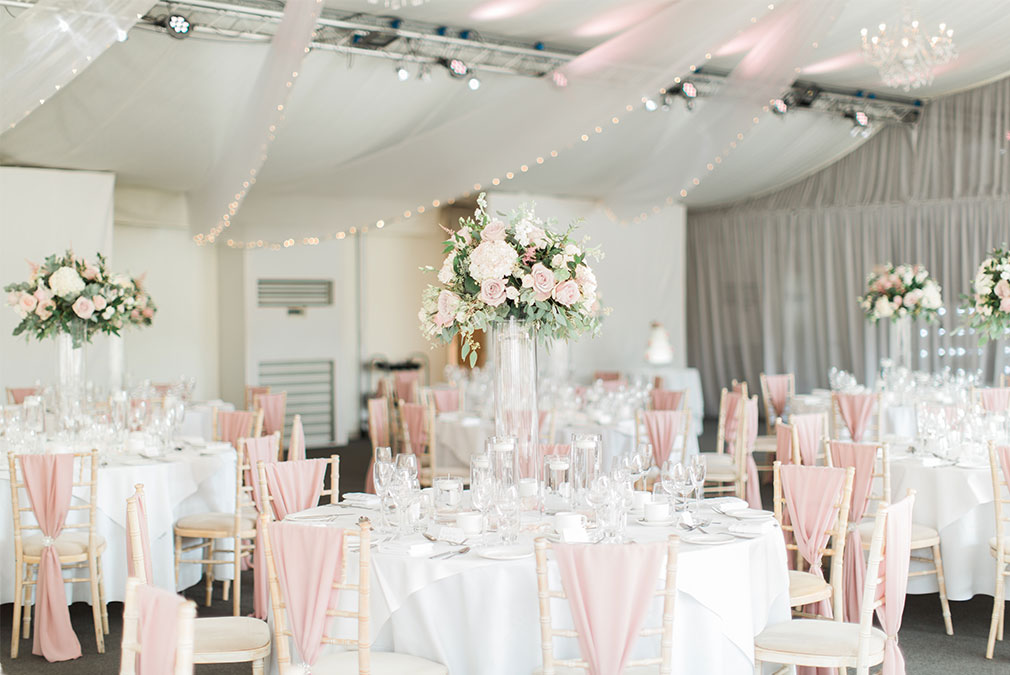 Wedding reception with pink décor at Braxted Park wedding venue in Essex