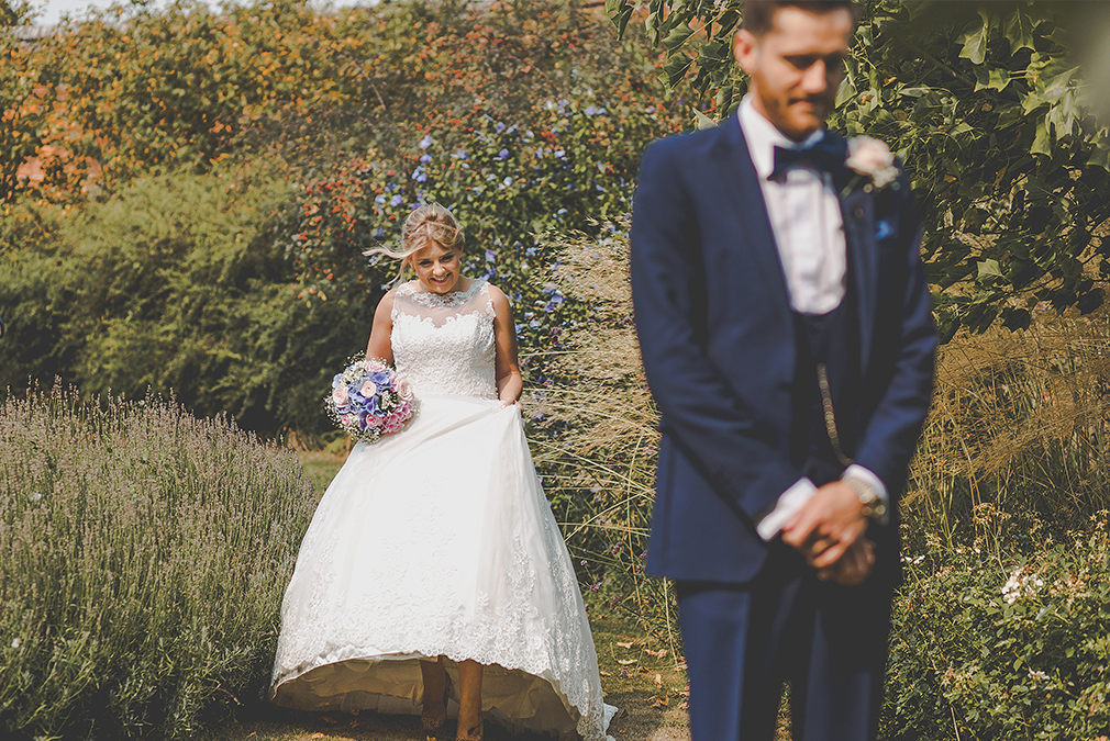 A special moment between the bride and groom in the gardens – country wedding