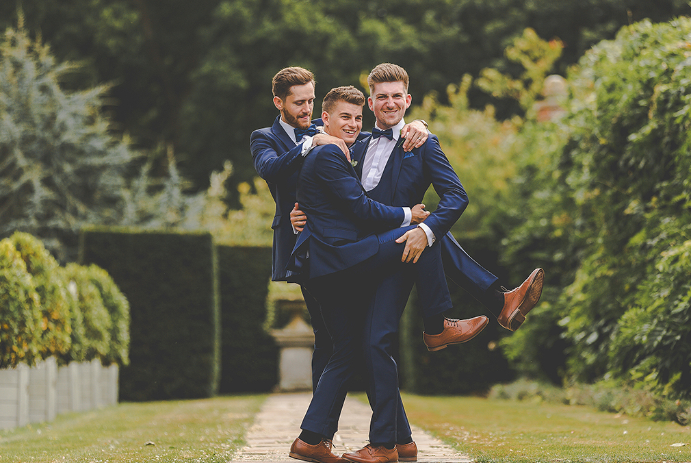 The groom and his groomsmen wore blue suits on his wedding day at Braxted Park – wedding venues in Essex