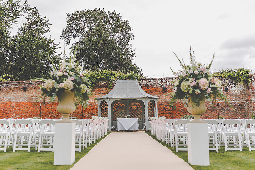 Hold the most romantic outdoor wedding in Braxted Park's summer house structure