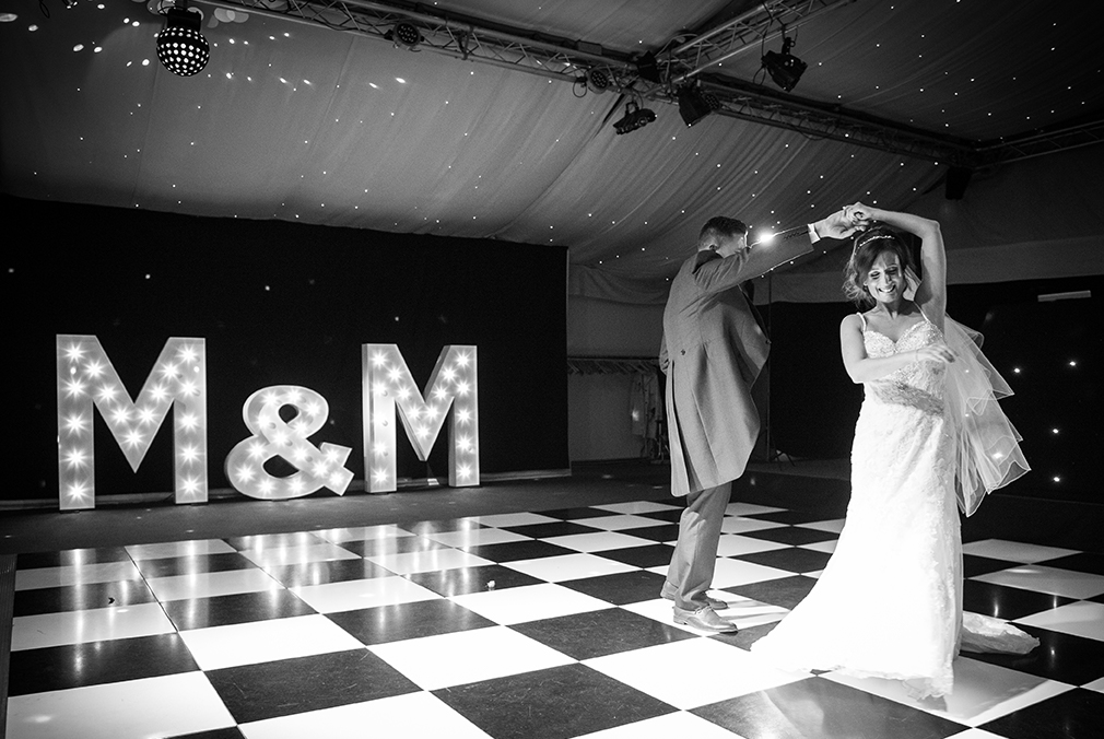 Madeline and Martyn enjoy their first wedding dance during the evening wedding reception