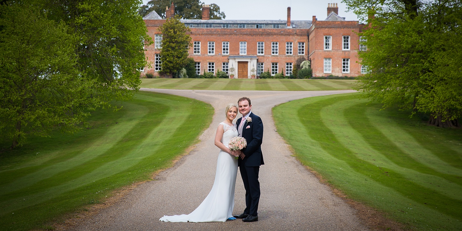 Katie and Rob steal a moment away as they stroll the grounds of one of the finest wedding venues in Essex