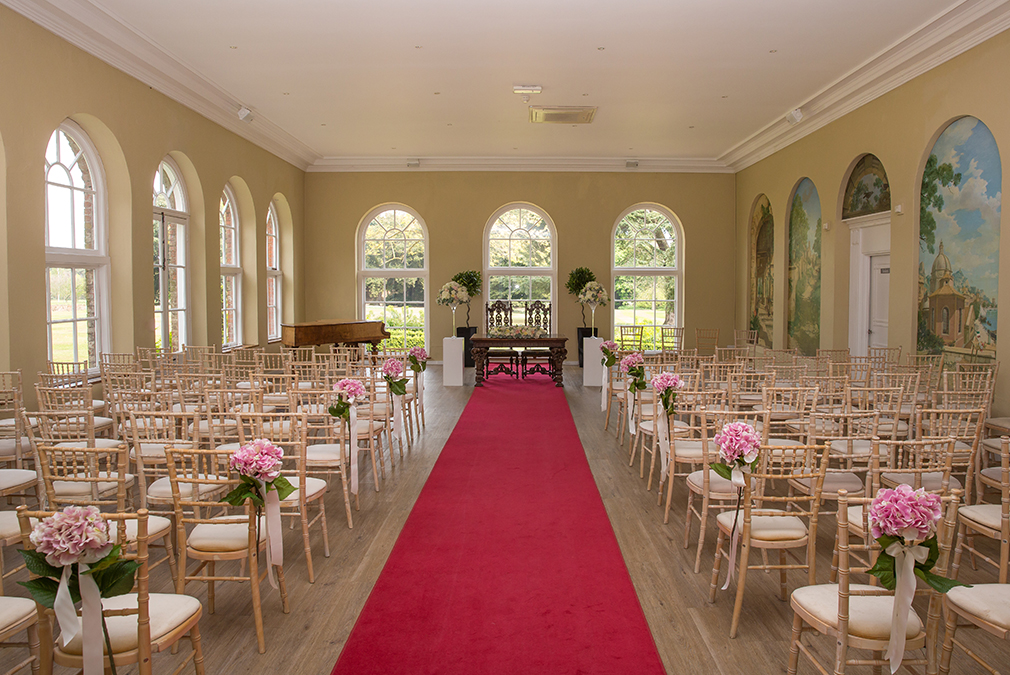 Exchange marriage vows in an intimate wedding ceremony in the elegant and light Orangery
