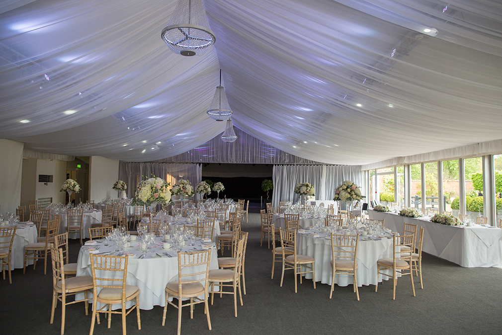 The newlyweds and their guests held their wedding reception in the Pavilion which is decorated with white flowers