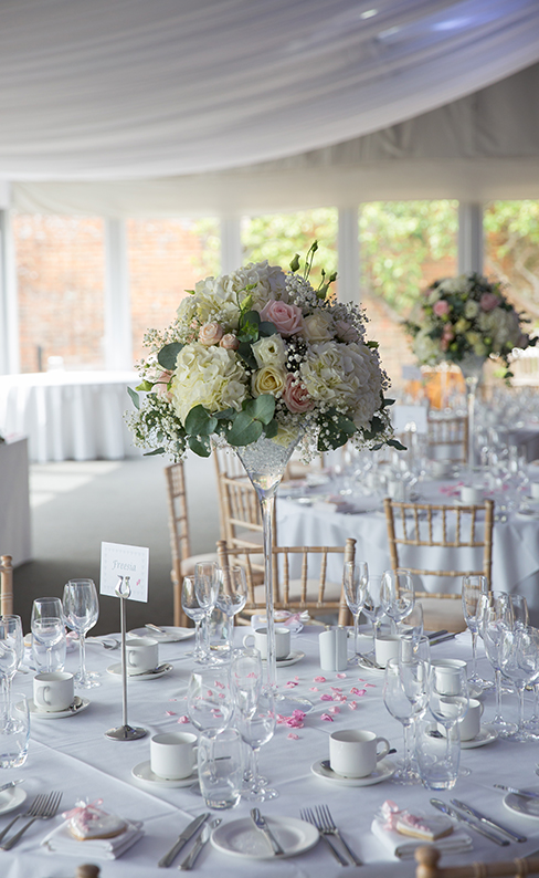 Tall vases filled with beautiful summer wedding flowers decorated the wedding reception – pastel wedding