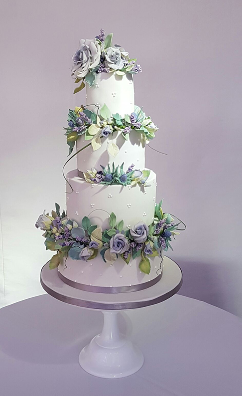 The couple had a four-tier white wedding cake decorated with lavender coloured fondant flowers