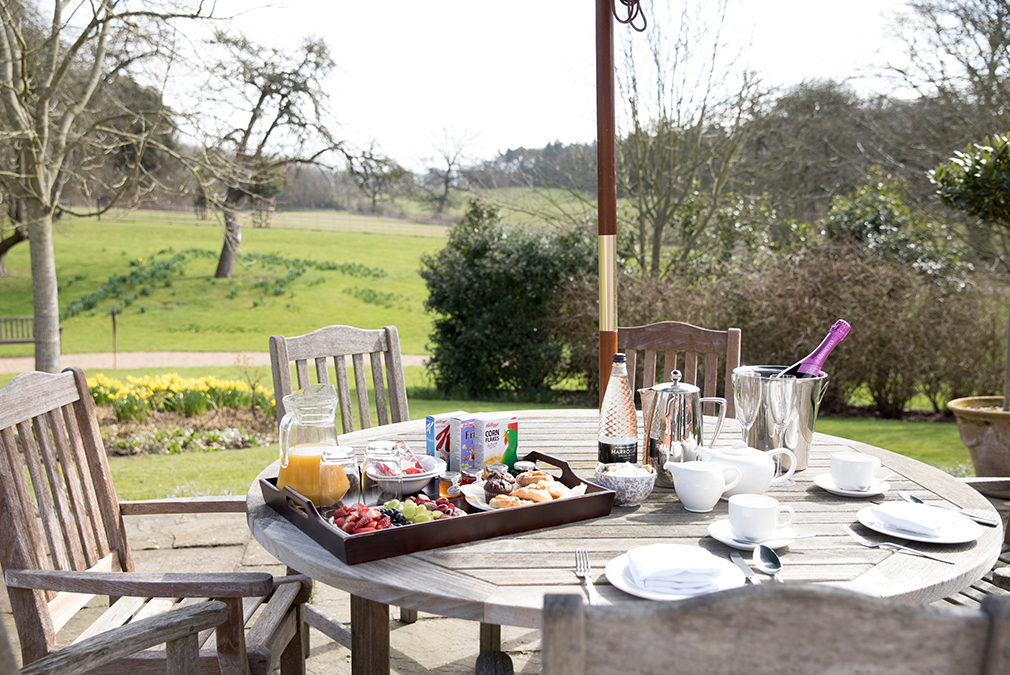 Enjoy a champagne breakfast in your very own private terrace at the Garden Cottage – Honeymoon accommodation