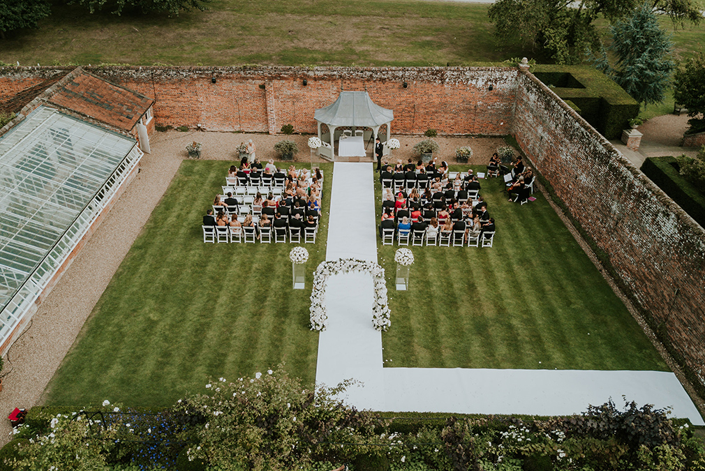 The fabulous and long wedding aisle at Braxted Park will create the perfect bridal entrance