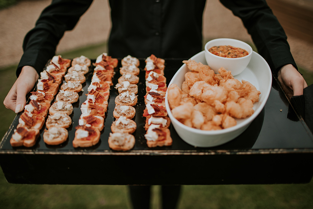 Make the most of the outdoor space and good weather by serving wedding canapes outdoors