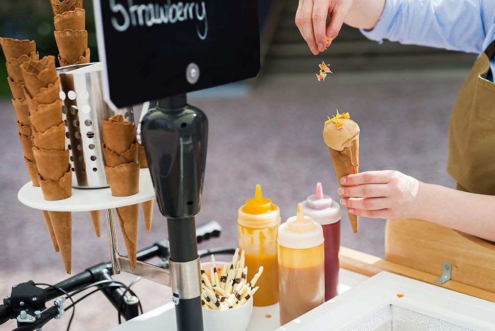 Keep guests cool with a vintage ice cream cart offering a variety of flavours and toppings – summer wedding ideas