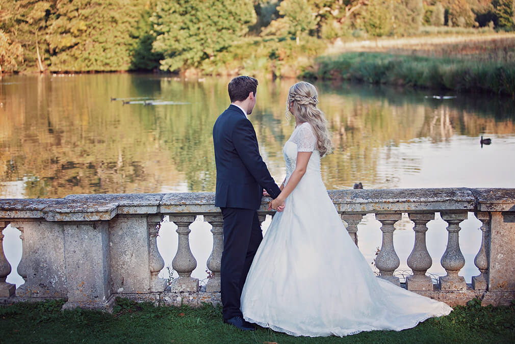 The bride and groom enjoy the gardens at this beautiful exclusive use country house wedding venue in Essex