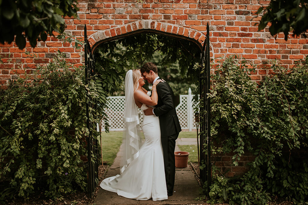 Newlyweds spend time taking wedding photos in the stunning gardens at Braxted Park wedding venue in Essex
