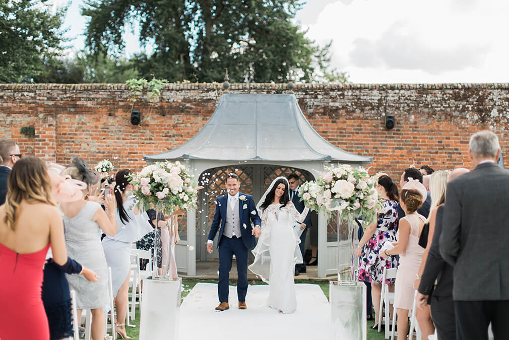 At Braxted Park country house wedding venue in Essex the newlyweds enjoy their outdoor ceremony