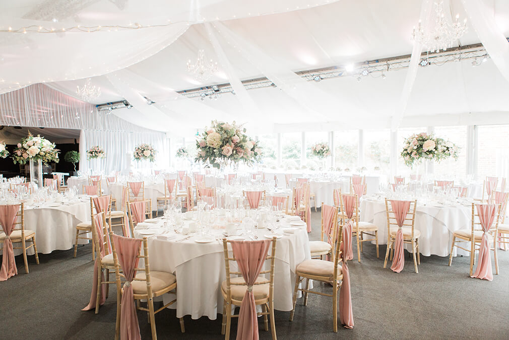 The Pavillion at Braxted Park country house wedding venue in Essex is set up for a beautiful wedding breakfast