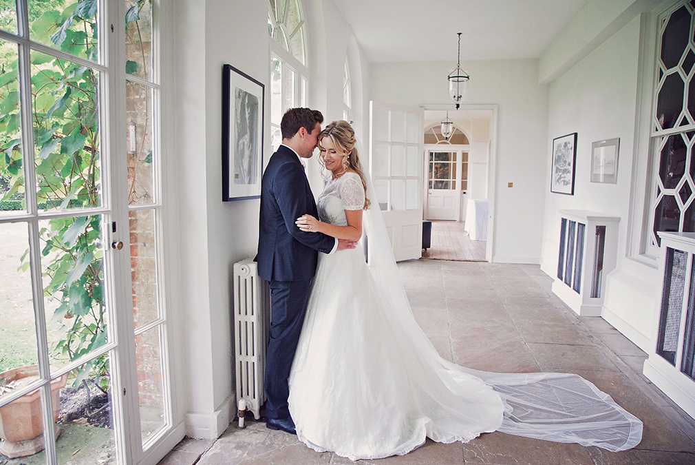 A bride and groom take a moment away from guests during their wedding day at this stunning wedding venue in Essex