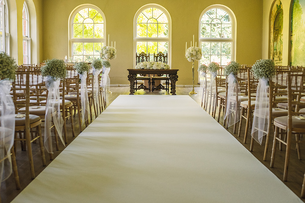 The Orangery at Braxted Park wedding venue in Essex is set up for a wedding ceremony