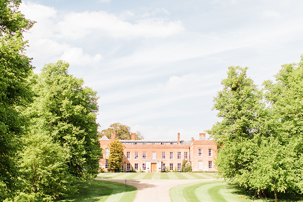 The grand driveway up to Braxted Park country house wedding venue is the perfect setting for beautiful wedding photos