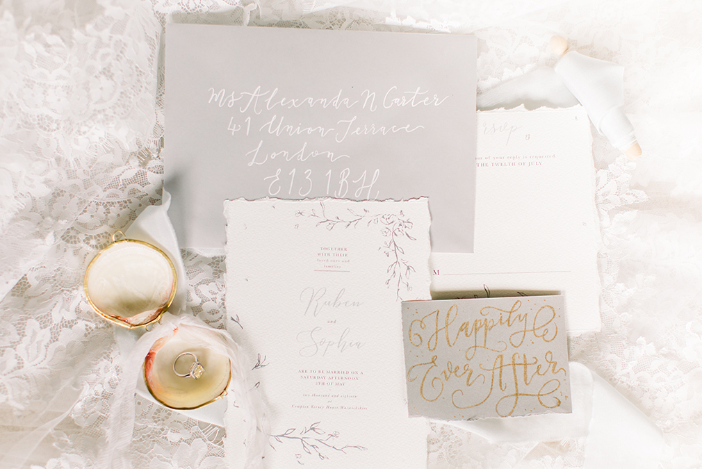 Grey and gold wedding stationery embraced the natural beauty of Braxted Park wedding venue in Essex
