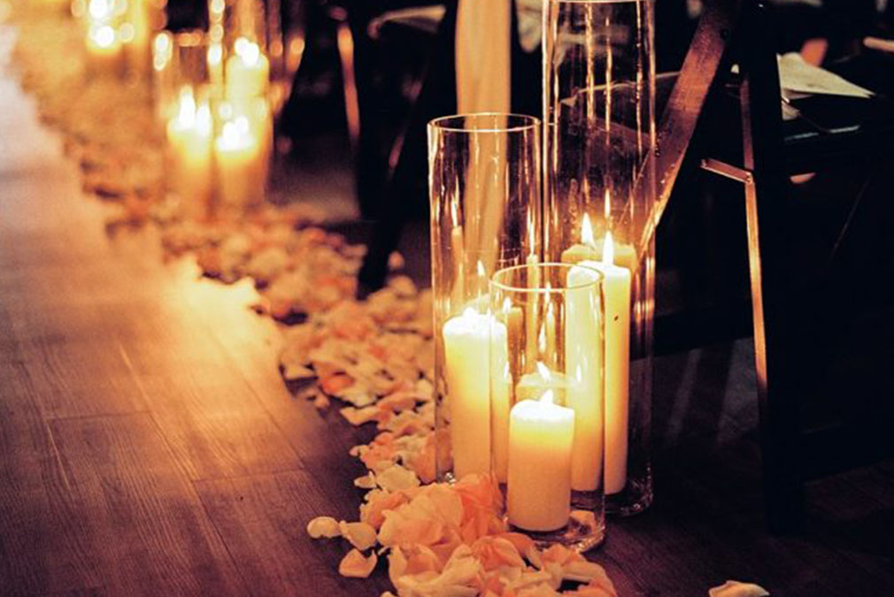 Line the wedding aisle at Braxted Park with candles for added romance