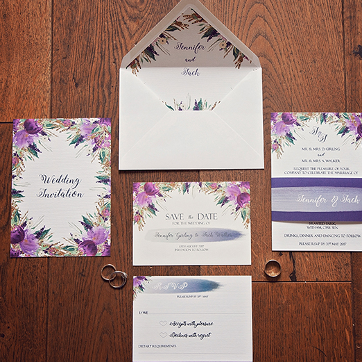 Wedding invitation envelopes with lavender coloured fondant flowers