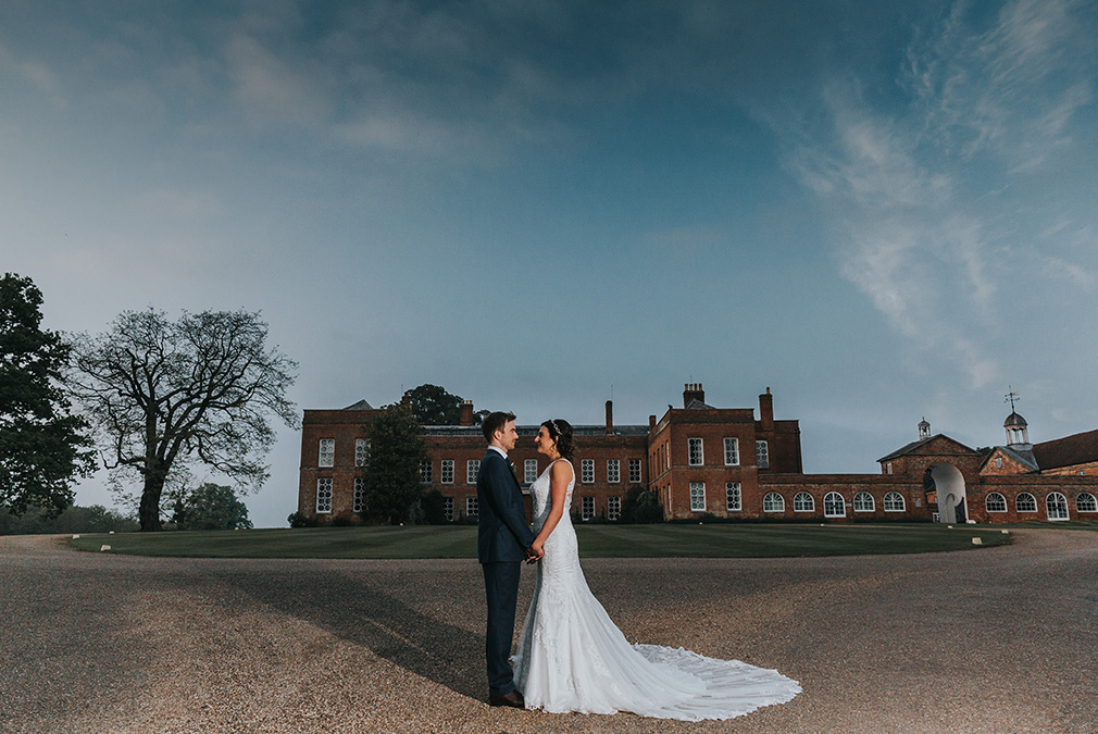 Newlyweds take a moment away from guests to explore the grounds at Braxted Park wedding venue in Essex