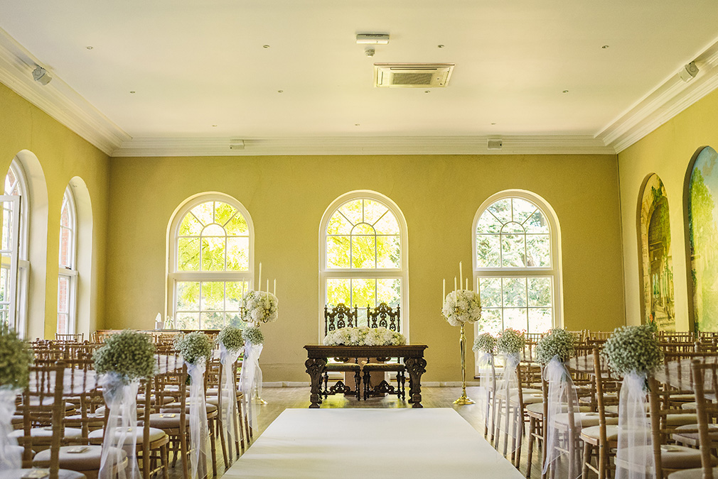 The Orangery at Braxted Park wedding venue in Essex is set up for a beautiful wedding ceremony