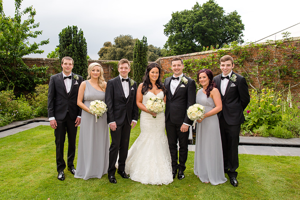 The bridesmaids wore grey one shoulder dresses whilst the men wore black tie tuxedos for this elegant wedding at Braxted Park