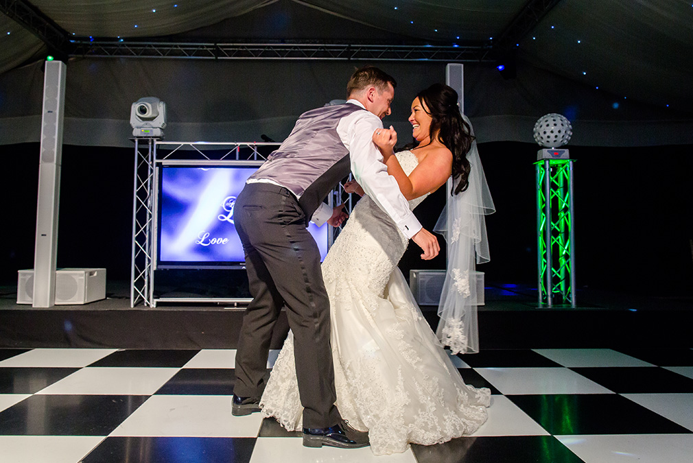 Newlyweds enjoy their first dance during their wedding reception at Braxted Park