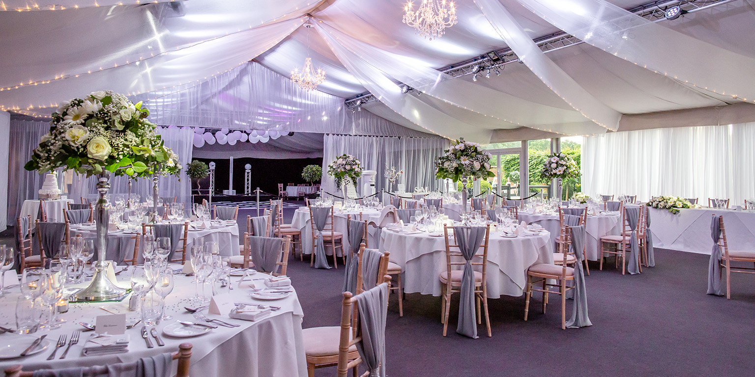 The Pavillion at Braxted Park is set up for a beautiful summer wedding breakfast