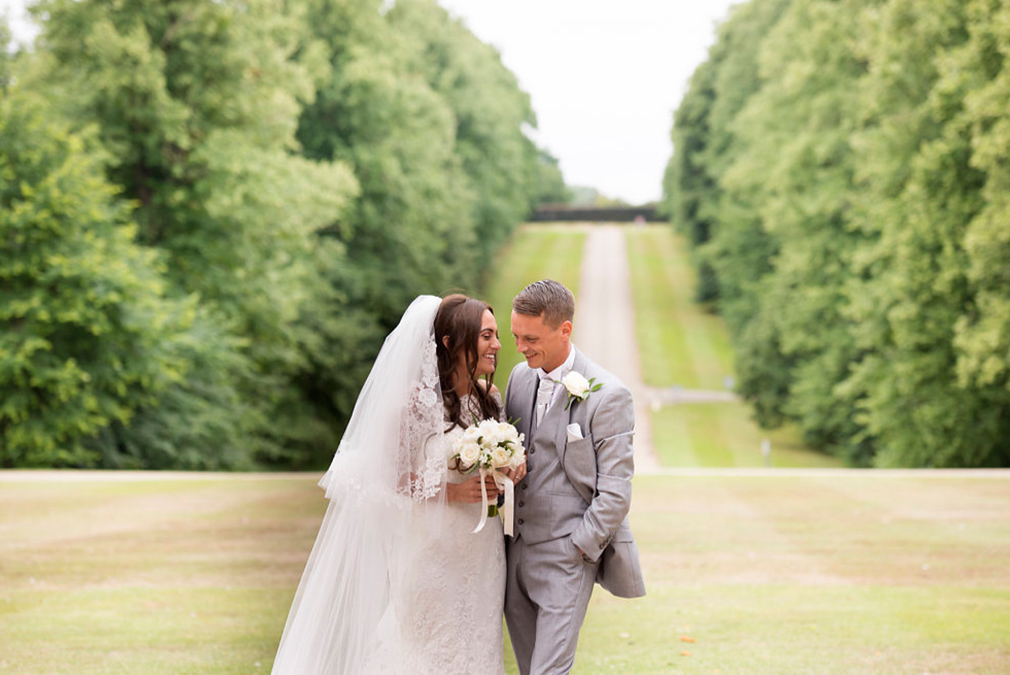 A bride and groom make the most of the grounds at Braxted Park on their spring wedding day