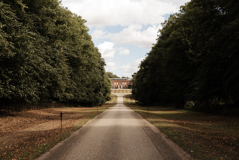 Make your way down the grand driveway at Braxted Park wedding venue in Essex on your wedding day