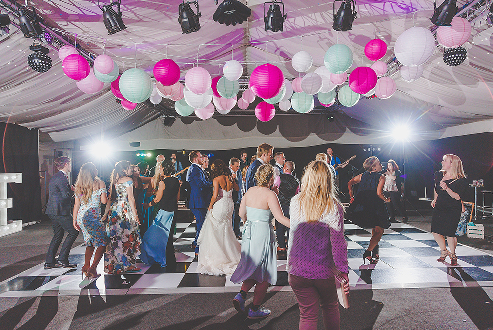 Wedding guests enjoy dancing during an evening reception at Braxted Park wedding venue in Essex
