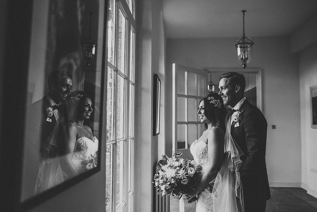 The new husband and wife make the most of the country house at Braxted Park on their wedding day