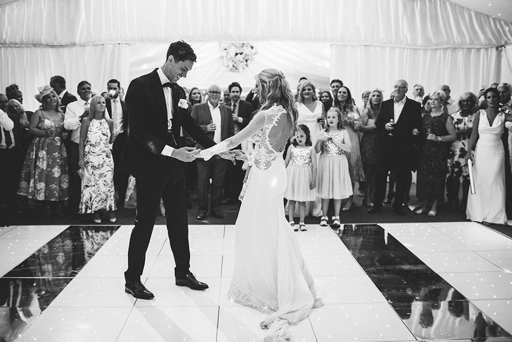 Newlyweds perform their first dance infront of guests during their wedding reception at Braxted Park in Essex