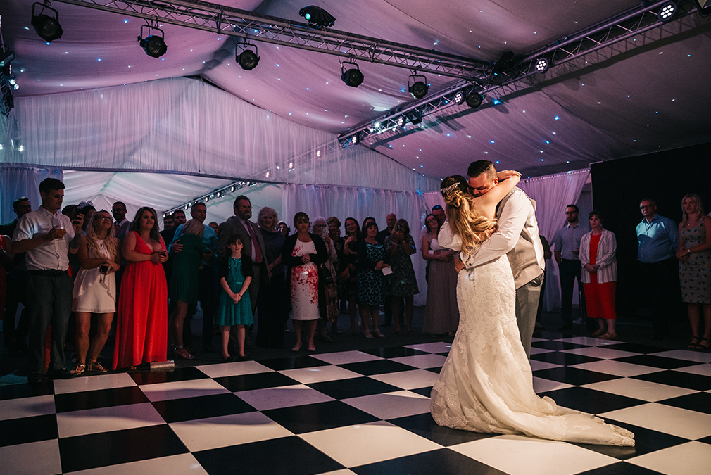 The newlyweds share their first dance as husband and wife on their wedding day at Braxted Park