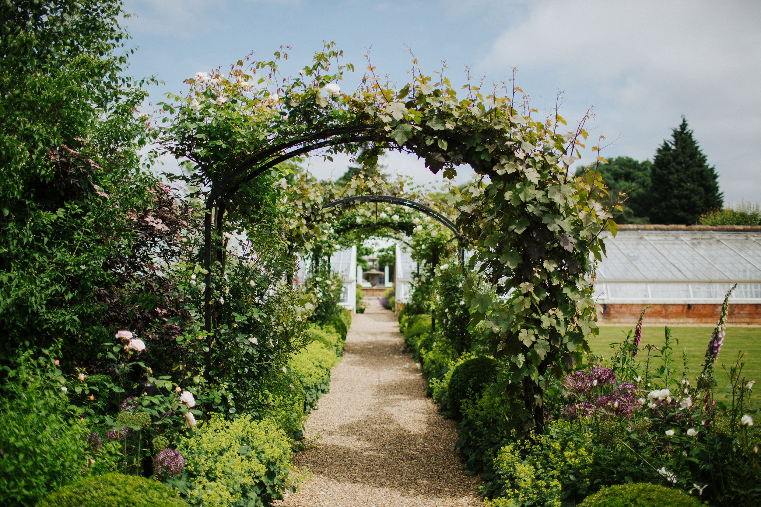 Use the gardens at Braxted Park wedding venue in Essex to capture beautiful wedding photos on your big day