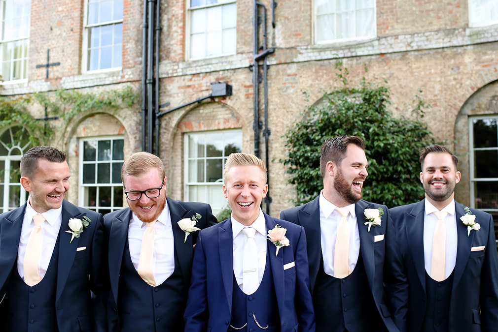 The groom and his groomsmen wore smart navy suits for this glamourous wedding day at Braxted Park