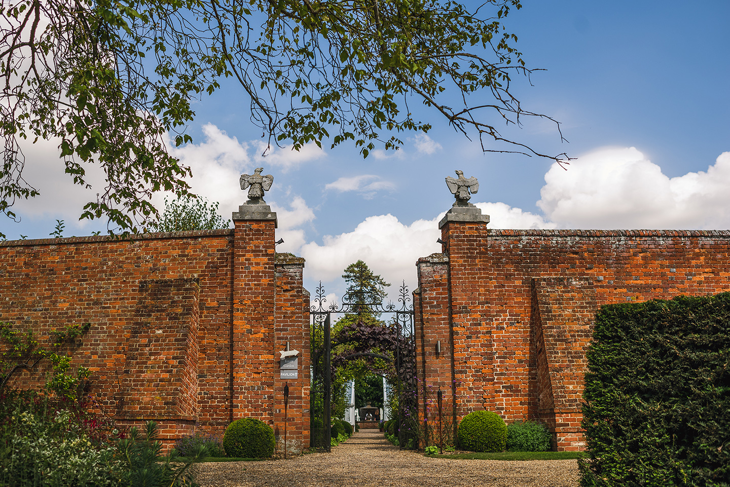 The magnificent gated entrance to the gardens at Braxted Park wedding venue in Essex