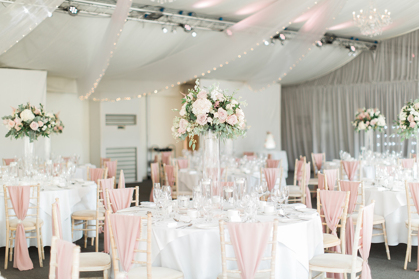The Pavilion at Braxted Park wedding venue in Essex is set up for an elegant wedding breakfast