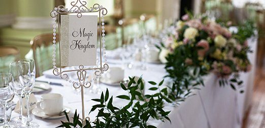The couple chose Disney table names for their wedding at Braxted Park