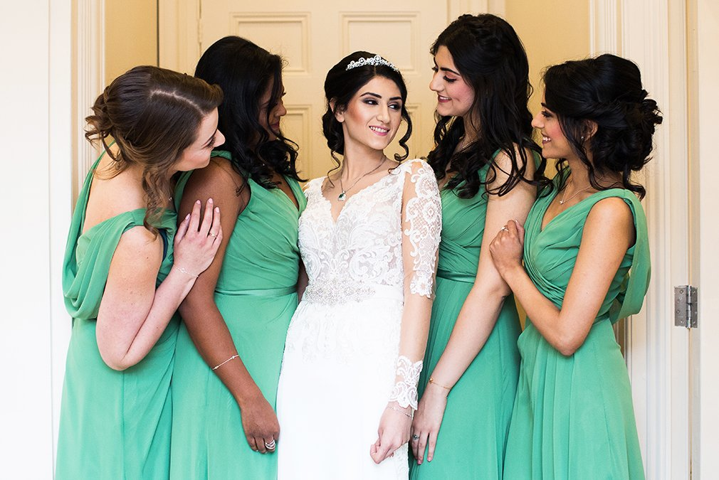 The bridesmaids all wore green bridesmaid dresses for this spring wedding at Braxted Park