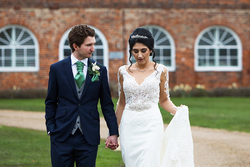 Newlyweds explore the grounds at Braxted Park following their wedding ceremony