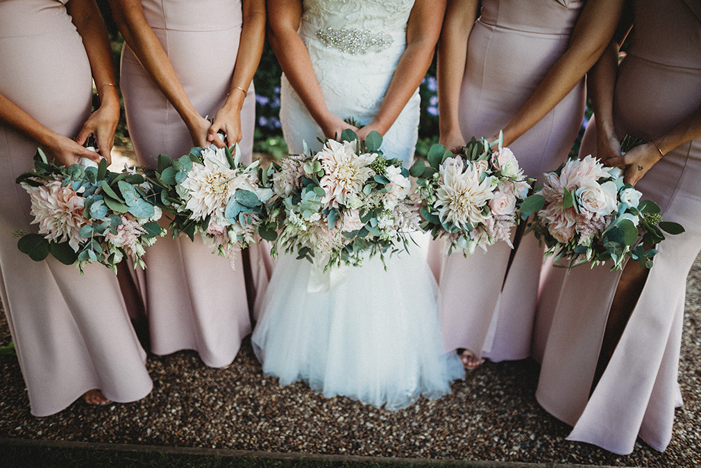 Bridesmaids at Braxted Park hold their summer wedding bouquets