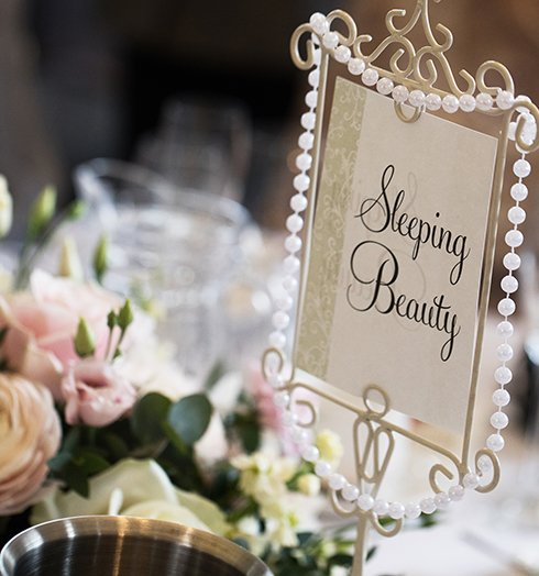 Disney table names were a perfect nod to the couples love of Disney at this spring wedding at Braxted Park