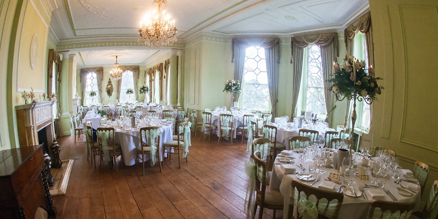 The Ballroom at Braxted Park wedding venue is dressed for a wedding reception